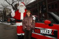 Jansen Panettiere and Santa Claus at the Ridemakerz unveiling of a toy Mini to the Boys and Girls Club.