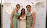 Faune Chambers with the Gran Centenario angels during the Mercedes Benz Fashion Week.