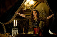 Noomi Rapace as Madam Simza Heron in
