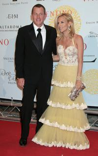 Lance Armstrong and Guest at the post haute couture show gala dinner and ball in Parco dei Daini.