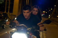 Taylor Lautner as Nathan and Lily Collins as Karen in