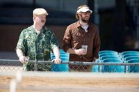 Jim Gaffigan as Lowell and John Krasinski as Burt in