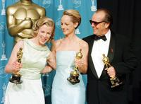 Kim Basinger, Helen Hunt and Jack Nicholson at the conclusion of the 70th Annual Academy Awards at the Shrine Auditorium in Los Angeles.