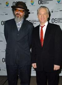 Director Larry Charles and Bill Maher at the premiere of