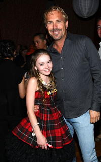 Madeline Carroll and Kevin Costner at the world premiere of