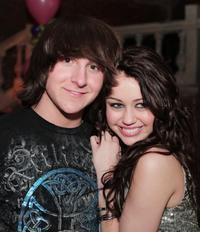 Mitchel Musso and Miley Cyrus at the after party of the premiere of