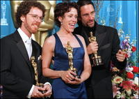 Frances McDormand, her husband Joel Coenand and his brother Ethan Coen at the 69th Academy Awards ceremony at the Shrine Auditorium in Los Angeles.