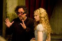 Tim Burton and Mia Wasikowska on the set of