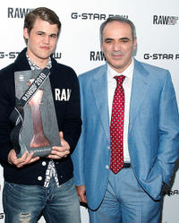 Magnus Carlsen and Garry Kasparov at the G-Star Raw World Chess Challenge in New York.