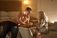 Liam Neeson as David Stewart and Amanda Seyfried as Chloe in