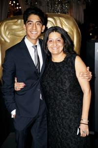 Dev Patel and Anita Patel at the Orange British Academy Film Awards.