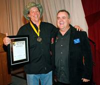 Ted Nugent and Bruce Gill at the National Bowhunters Hall of Fame during the National Field Archery Association's World Archery Festival.