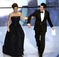 Keanu Reeves and Sandra Bullock at the 78th Academy Awards.