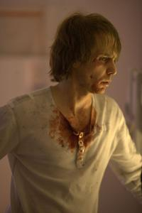 Sam Rockwell as Sam Bell in