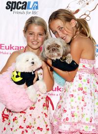 Noah Cyrus and Guest at the grand opening party for the Artist Knox Luxury Grooming Pet Salon.