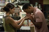 Rosario Dawson and Will Smith in