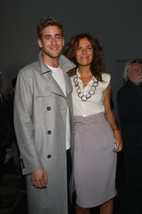 Oliver Jackson-Cohen and Roberta Armani at the Emporio Armani fashion show during the Milan Fashion Week Menswear Spring/Summer 2012 in Italy.