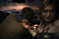 Eric Sheffer Stevens as Peter and Elizabeth Olsen as Sarah in ``Silent House.''