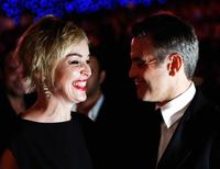 Sharon Stone and George Clooney at the opening of 4th Dubai International Film Festival.