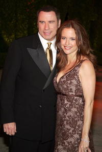 John Travolta and actress Kelly Preston arrive at the Vanity Fair Oscar Party.