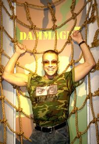 Jean-Claude Van Damme poses for photographers at the launch his clothing range