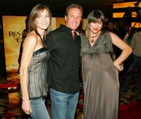 Susan Walters, husband Linden Ashby and Milla Jovovichat the premiere of