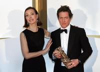 Carole Bouquet and Hugh Grant at the 31th Nuit des Cesar.