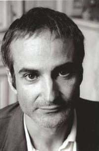 Director Olivier Assayas on the set of