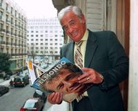 Jean-Paul Belmondo as he flips through his biography.