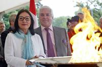 Jean-Claude Brialy and Greek singer Nana Mouskouri welcome the arrival of the Olympic flame.