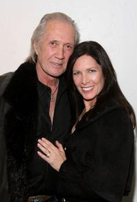 David Carradine and Annie Bierman at the premiere of