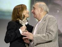 Claude Chabrol as he gives the award to Isabelle Huppert at the 56th Berlin International Film Festival.