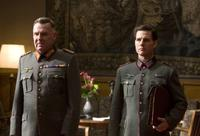 Tom Cruise as Colonel Claus von Stauffenberg and Tom Wilkinson as Friedrich Fromm in