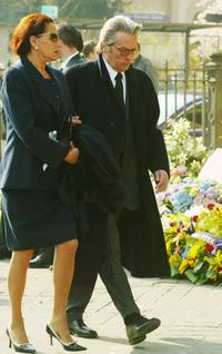 Alain Delon and a friend at the Saint Francois Xavier church to attend Jean-Luc Lagardere's funeral.
