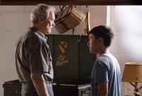 Clint Eastwood as Walt Kowalski and Bee Vang as Thao in