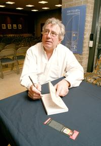 Terry Jonessigns signs his new book