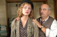 Nora Arnezeder as Douce and Gerard Jugnot as Pigoil in