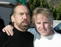 Gary Busey poses with John Paul DeJoria at the annual party.