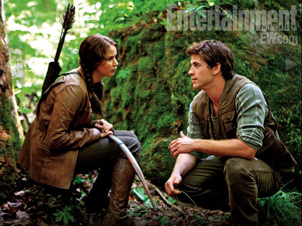 Jennifer Lawrence as Katniss and Liam Hemsworth as Gale