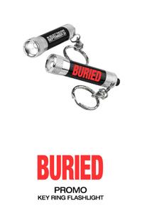 'Buried' flashlight keychain