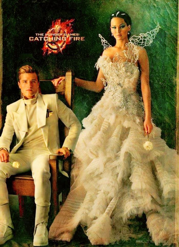 catching fire movie poster peeta and katniss
