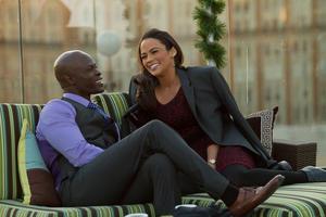 "Djimon Hounsou as Quinton and Paula Patton as Montana Moore in ""Baggage Claim."""