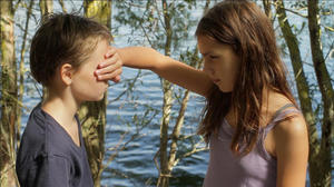 "Zoe Heran as Laure/Mikael and Jeanne Disson as Lisa in ""Tomboy."""