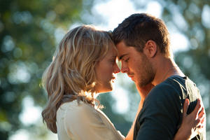 "Taylor Schilling as Beth Green and Zac Efron as Logan Thibault in ""The Lucky One."""