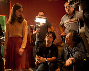 "Mia Wasikowska and director Chan-wook Park on the set of ""Stoker."""