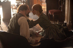 "Ralph Fiennes as Charles Dickens and Felicity Jones as Nelly Ternan in ""The Invisible Woman."""