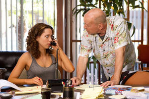 "Rebecca Hall and Bruce Willis in ""Lay the Favorite."""