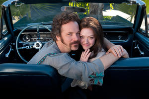 "Peter Sarsgaard as Chuck Traynor and Amanda Seyfried as Linda Lovelace in ""Lovelace."""