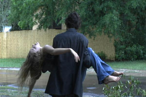 "Scott (Damian Lahey) carries Mary (Kelly Forester) in ""Cocaine Angel."""