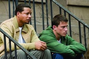 "Terrence Howard as Harvey Boarden and Channing Tatum as Shawn MacArthur in ""Fighting."""
